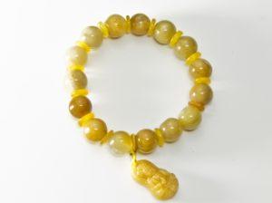 фото браслета из желтого жадеита с буддой